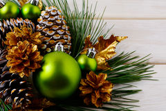 Christmas green ornaments and golden decorated pine cones Stock Photo