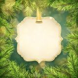 Christmas green pine branches and tag frame with copyspace. EPS 10 royalty free illustration