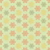 Christmas green seamless pattern with red and yellow snowflakes. Stock Photography