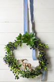 Christmas green wreath of evergreen and berries on white background Royalty Free Stock Photography