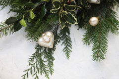 Christmas greenery with cameo ornament Stock Photography