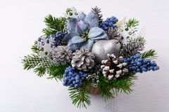 Christmas greenery with silver glitter decor and blue silk poins Stock Images