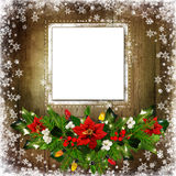 Christmas greeting background with card, pine branches, poinsettia, berries branches, garland lights on a wooden background. Card for photo or text, pine Stock Photo
