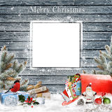 Christmas greeting background with card with space for text or photo , gifts, a mailbox with letters, pine branches and christmas Royalty Free Stock Photography