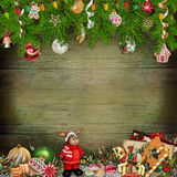 Christmas greeting background with Christmas toys, pine branches, sweets Royalty Free Stock Photography