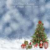 Christmas greeting background with Christmas tree and gifts Stock Images