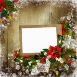 Christmas greeting background with frame, pine branches, poinsettia, berries branches. Frame for photo or text, pine branches, poinsettias, garland lights Royalty Free Stock Image