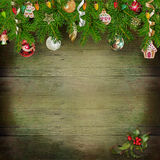 Christmas greeting background with pine branches and Christmas ornaments on the wooden background Royalty Free Stock Images