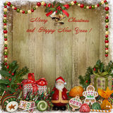 Christmas greeting background with Santa, gifts and candies Royalty Free Stock Image