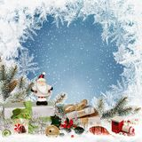 Christmas greeting background with space for text, with gifts, sweets, Santa Claus, pine branches, Christmas decorations and frost Royalty Free Stock Photo