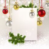 Christmas Greeting Banner with Christmas Balls and a Spruce Bran. Ch on a pearly background Royalty Free Stock Photos