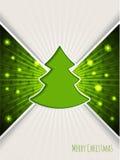 Christmas greeting with bursting green christmas tree Stock Photos