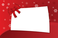 Christmas Greeting Card. With ribbon and snowflakes on red background Royalty Free Stock Photo