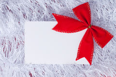Christmas greeting card. With red bow Royalty Free Stock Photo