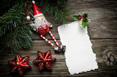Christmas greeting card. Greeting card for Christmas with Santa Claus decoration and candles Stock Photography