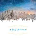 Christmas greeting card. Against snowy landscape with fir trees Royalty Free Stock Image