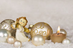 Christmas greeting card with angel and candle in gold, silver an Stock Photo