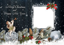 Christmas greeting card with an angel, pine branches and Christmas decorations Stock Photos