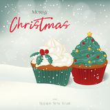Christmas greeting card, background, poster with sweet cupcakes in the snow.  Stock Photo