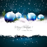Christmas greeting card. With baubles and branches in snow Royalty Free Stock Photo