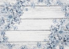 Christmas greeting card with beautiful blue flowers on a wooden board royalty free illustration