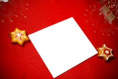 Christmas greeting card with biscuits Stock Image