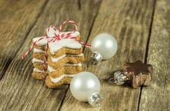 Christmas greeting card with biscuits and xmas balls Stock Images