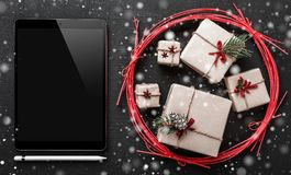 Christmas greeting card, black ipad to write a message for loved ones and dear ones, winter symbolic holiday gifts. Christmas greeting card, black ipad to write stock photo