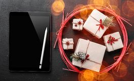 Christmas greeting card, black ipad to write a message for loved ones and dear, symbolic gift of winter celebration. Christmas greeting card, black ipad to royalty free stock image