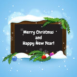 Christmas greeting card. Blackboard in wooden frame with fir branches and christmas baubles Royalty Free Stock Photography