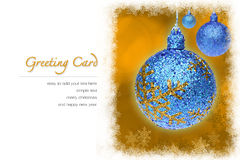Christmas greeting card. Blue Christmas ball and yellow bokeh background with copy space and snowflakes border. easy to add your text Stock Images