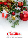 Christmas greeting card - border from fir three and gifts in snow Stock Image