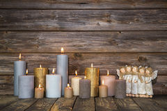 Christmas greeting card with candles and angels on wooden backgr Royalty Free Stock Image