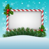 Christmas greeting card with candy and blank sign Stock Photography