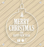 Christmas greeting card in christmas ball on wooden background Stock Photography