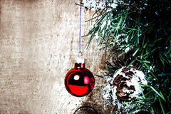 Christmas greeting card with Christmas Decorations on grunge woo Stock Images