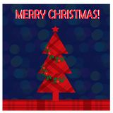 Christmas greeting card with christmas tree on the blur background. royalty free stock images
