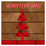 Christmas greeting card with christmas tree on the wooden background. stock photo