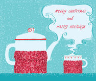 Christmas greeting card with cup tea and kettle background Royalty Free Stock Image