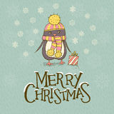 Christmas greeting card with a cute penguin Royalty Free Stock Photography