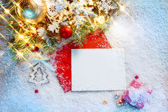 Christmas greeting card with decorated fir tree on snow Stock Image