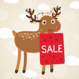 Christmas greeting card with deer and sale bag. Stock Photo