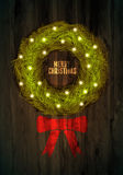 Christmas greeting card design with Christmas wreath on wood background Royalty Free Stock Images