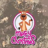 Christmas reindeer pointing at something in a circle. Merry christmas calligraphy. Old paper and Grunge effect with Royalty Free Stock Photo