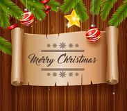 Christmas greeting card. With empty paper with calligraphic inscription on wooden background Stock Images