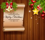 Christmas greeting card. With empty paper with calligraphic inscription on wooden background Stock Photography