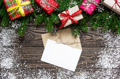Christmas greeting card with envelope on rustic wooden background Royalty Free Stock Photography