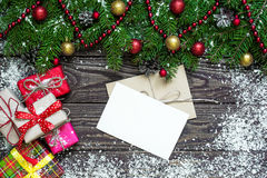 Christmas greeting card with envelope on rustic wooden background Stock Photos