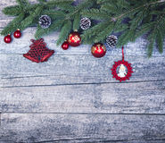 Christmas Greeting Card - Fir Branch And Decoration On Planking. Stock Image