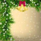 Christmas Greeting card with fir twigs and jingle bells Royalty Free Stock Photo